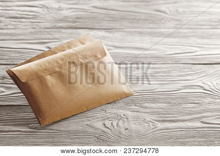 Kraft Envelopes With Letters On Old White Wooden Background. Blanks For The Designer. Concepts, Idea