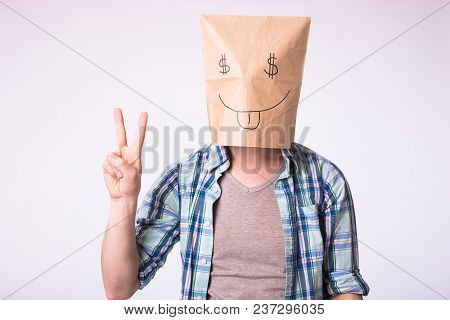Economy, Emotion, And Money Concept - Man With Cardboard Box On His Head With Picture Of Dollar Symb