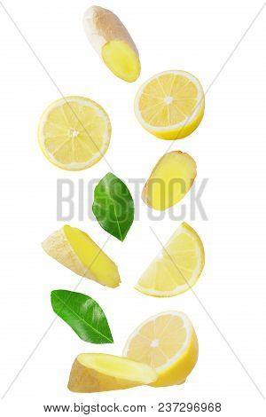 Isolated Flying Fruits. Falling Lemon And Ginger Isolated On White Background With Clipping Path As