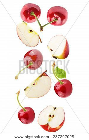 Isolated Falling Fruits. Falling Apple And Cherries Isolated On White Background With Clipping Path