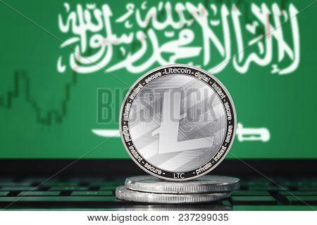 Litecoin (ltc) Cryptocurrency; Coin Litecoin On The Background Of The Flag Of Saudi Arabia (ksa)