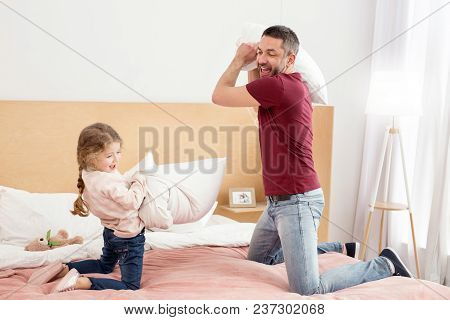 Pillow Battle. Happy Charming Daughter Spending With Her Daddy And Having A Pillow Battle