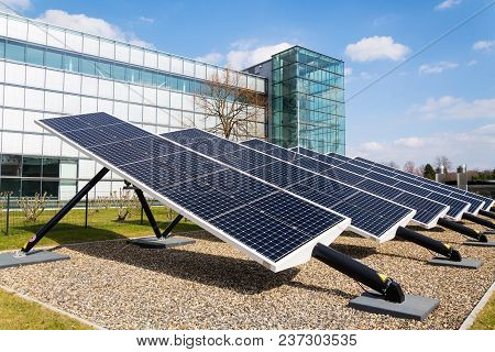 Blue Rotating Solar Panels Tilted Axis Tracker, Future Energy Concept