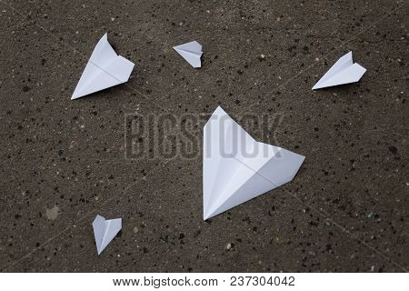 Moscow, Russia - April 22, 2018: Paper Planes Lie On The Asphalt. Action To Launch Aircraft In Suppo