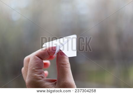 Moscow, Russia - April 22, 2018: A Paper Airplane In His Hand. Action To Launch Aircraft In Support