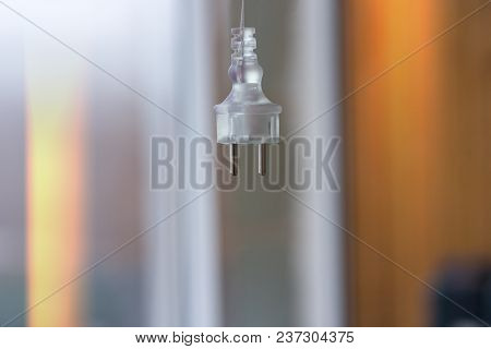 Electric Plug On A Blurred Background Hangs
