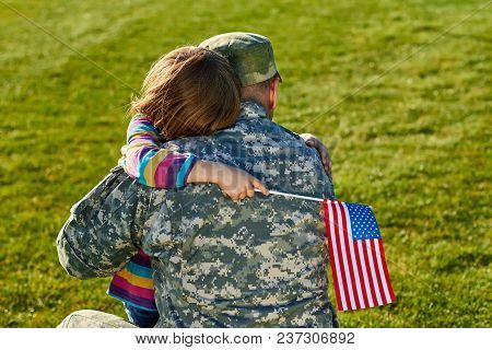 Touching Us Army Soldier Reunion With Little Daughter. A Young Child Is Hugging His Army Soldier Fat