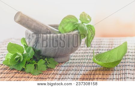 Marble Mortar And Pestle With Aromatic Herbs.