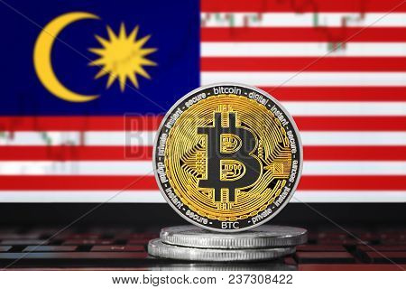 Bitcoin (btc) Cryptocurrency; Coin Bitcoin On The Background Of The Flag Of Malaysia