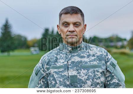 Portrait Of Mature Caucasian Soldier. Serious Caucasian Man In Military Uniform, Front View.