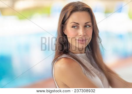 Closeup authentic portrait of a beautiful brunette woman outdoors, genuine beauty of a female with natural makeup, sensuality and feminity concept