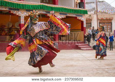 Lamayuru, India - June 21, 2017: Unidentified monk in mask perform a religious masked mystery dance of Tibetan Buddhism during the Yuru Kabgyat Buddhist festival at Lamayuru Gompa, Ladakh.
