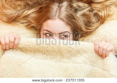 Woman Waking Up In Bed In The Morning After Sleeping. Well Rested Young Girl Laying Covering Face Wi