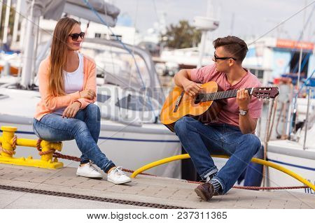 Love Romance Affection Music Sound Talent Concept. Girl Charmed By Musican. Young Guitarist Playing