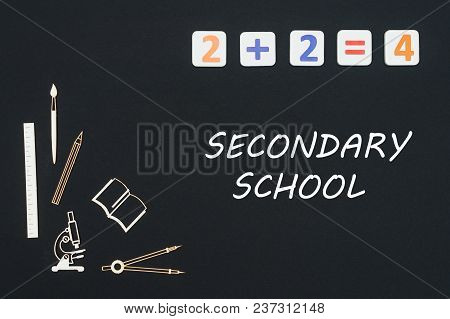 Concept First Class School, Text Secondary School With Wooden Miniatures School Supplies And Element