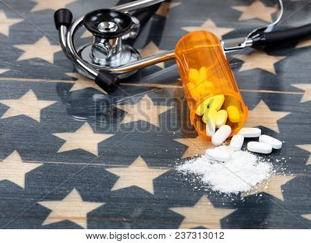 Close Up Front View Of Prescription Bottle With Generic Opioid Pain Killer Tablets. Rustic Usa Flag