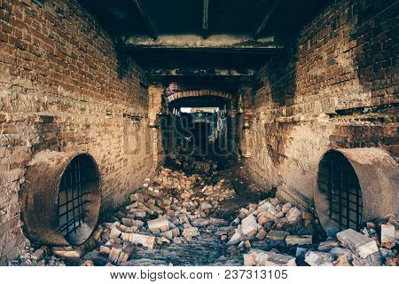 Red Brick Ruined Abandoned Underground Sewer Tunnel With Dramatic Mysterious Atmosphere, Inside Sewe