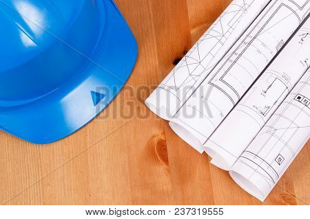 Diagrams Or Electrical Construction Drawings And Protective Blue Helmet For Engineer Jobs On Desk, T