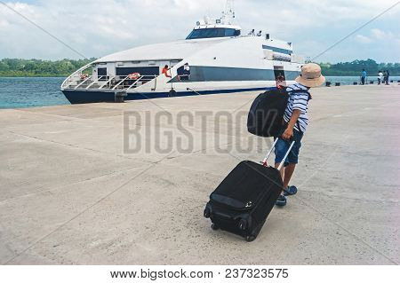 Young Guy Blocking With A Backpack And Suitcase Goes Into A Cruise On The Liner. Youngster Teen Tour