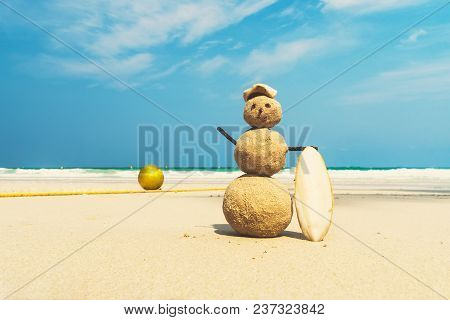 Tourist Traveler Blinded By The Sand On Beach Amid The Beautiful Sea And Blue Cloudy Sky. Concept Of