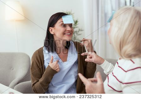 Funny Game. Enthusiastic Elder Woman And Caregiver Chatting While Playing Game