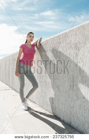 Confident Slender Girl Resting After A Workout Outdoors, Wants To Lose Weight