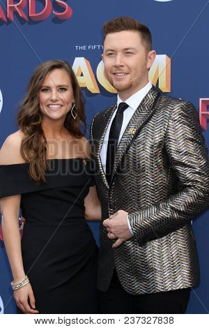 LAS VEGAS - APR 15:  Gabi Dugal, Scotty McCreery at the Academy of Country Music Awards 2018 at MGM Grand Garden Arena on April 15, 2018 in Las Vegas, NV