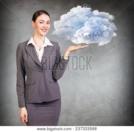 Businesswoman Holding Cloud With Different Digital Icons. Technology Concept.