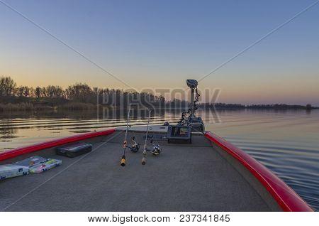 Fishfinder, Echolot, Fishing Sonar At The Boat With Fishing Tackles