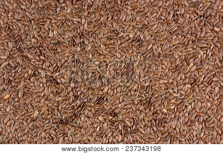 Brown Flax Seeds. Also Known As Linseed, Flaxseed And Common Flax. Pile Of Grains, Isolated White Ba