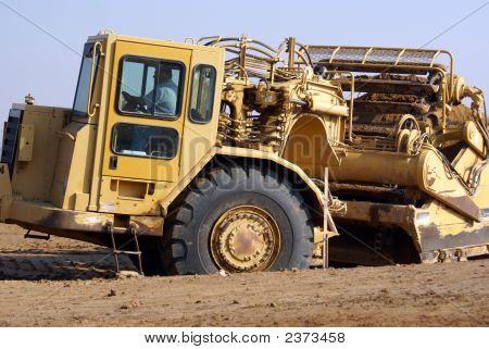 Tractor With Scraper/Spreader