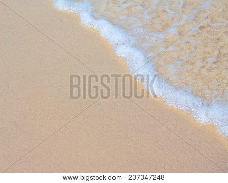Sea Wave And White Sand Beach Photo Background. Sunny Beach Sand With Sea Wave. White Sand Of Oceani