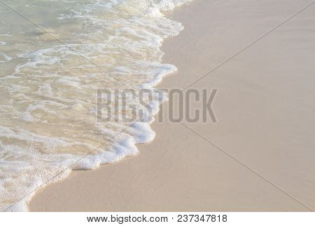 Sea Wave And Sand Beach Photo For Background. Sunny Beach Sand With Sea Wave. White Sand Of Marine C