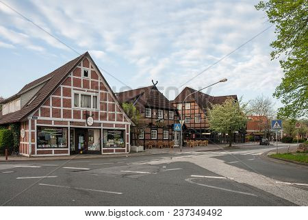 Hittfeld, Germany - May 11, 2013: Deserted Street In A Quiet Provincial German Town In The Early Spr