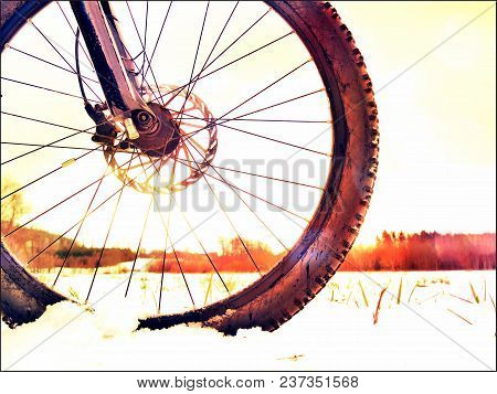 Abstract Effect. Front Bike Detail On A Winter Trail, Path Covered By Snow. Sportive Backgrounds And