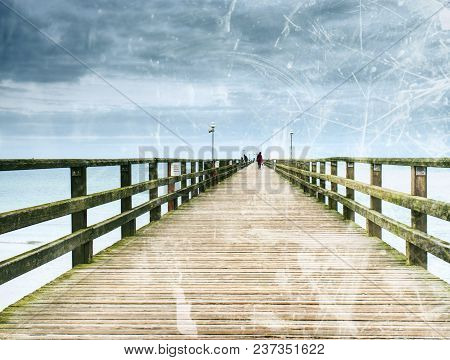 Abstract Effect.  Old Wood Beach Bridge In Goehren With Nobody. Autumnal Misty Weather With Cloudy S