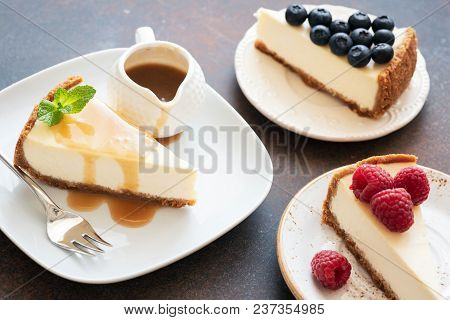 Assortment Of Cheesecakes With Different Toppings. Cheesecake With Raspberries, Cheesecake With Cara