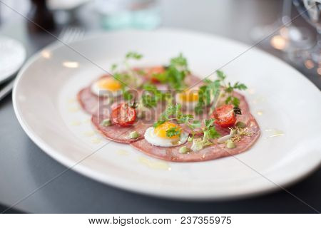 Gourmet Presentation Of Bacon And Eggs