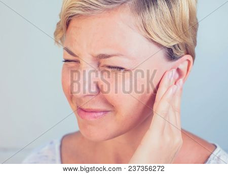 Young Female Having Ear Pain Touching Her Painful Head Earache