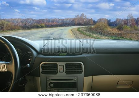 View From Salon Of Car Going On Road