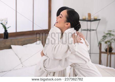 Lesbian Couple. Happy Positive Joyful Women Hugging Each Other While Visiting A Spa Salon