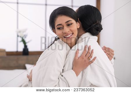 Lesbian Relationships. Delighted Nice Positive Woman Smiling While Hugging Her Girlfriend