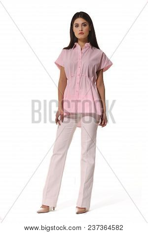 Young Caucasian Business Woman Executive Posing In Summer Pink Powder Short Sleeve Blouse White Trou