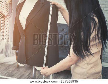 Fashion Designer Hand Is Measuring Jacket Length