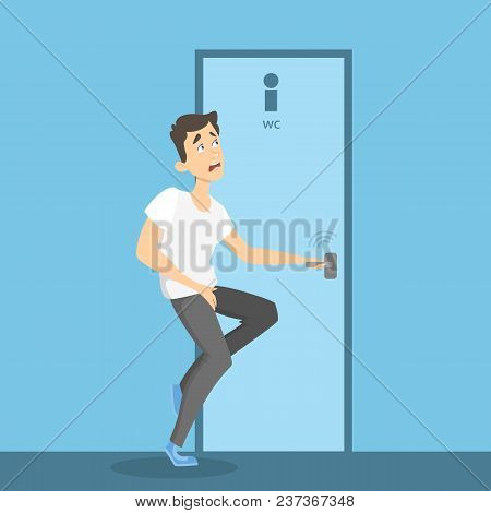 Man Wants To Pee. Strong Urge To Urinate. Closed Bathroom.