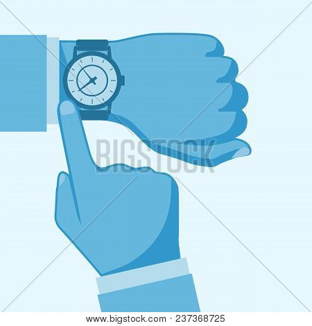 Wristwatch On The Hand Of Businessman In Suit.time On Wrist Watch. Man With Clock Checks The Time. H