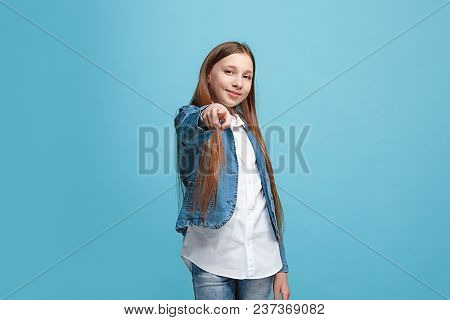 I Choose You And Order. The Smiling Teen Girl Pointing To Camera, Half Length Closeup Portrait On Bl