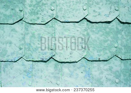 Metal Background With Hammered Metal Plates With Rivets On The Metal Surface Covered With Peeling Pa