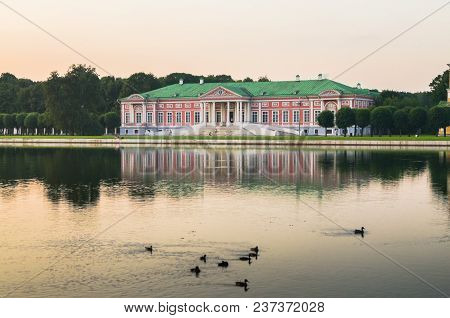 Evening serenity of the palace pond, included into ensemble of the State reserve museum Kuskovo, former aristocratic summer country estate of the russian nobility of the 18th century. Moscow. Russia. poster