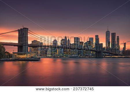 Brooklyn bridge at dusk, New York City. USA - State New York. Postcard view to the big apple